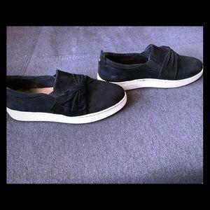 Earth slip on sneakers